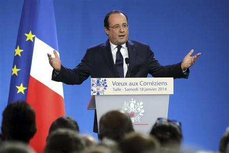French President Hollande delivers his New Year's greetings to the residents of the region of Correze, in Tulle
