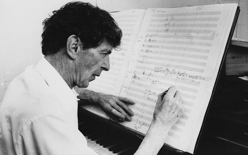 Composer Sir Michael Tippett, whose opera The Midsummer Marriage was first performed in 1955, pictured at the piano in 1974 - Radio Times/Getty Images