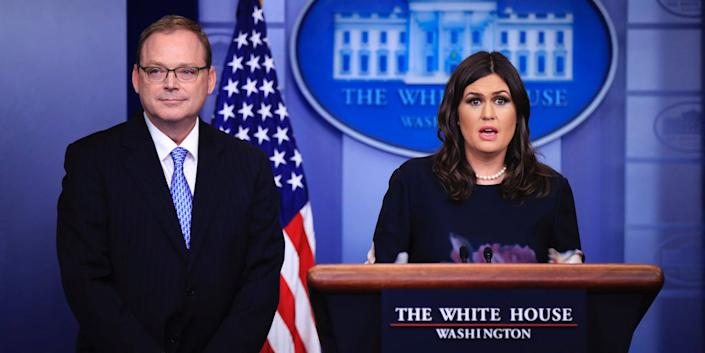 White House press secretary Sarah Huckabee Sanders, right, introduces Kevin Hassett, chair of the Council of Economic Advisers, to the media during a press briefing in the Brady press briefing room at the White House, in Washington, Friday, Nov. 17, 2017.