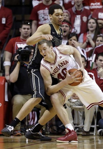 Indiana forward Cody Zeller, right, drives on Purdue center A.J. Hammons in the first half of a NCAA college basketball game in Bloomington, Ind., Saturday, Feb. 16, 2013. (AP Photo/Michael Conroy)
