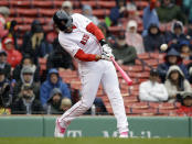 Boston Red Sox's J.D. Martinez hits a home run off a pitch by Seattle Mariners' Marco Gonzales during the first inning of a baseball game at Fenway Park, Sunday, May 12, 2019, in Boston. (AP Photo/Steven Senne)