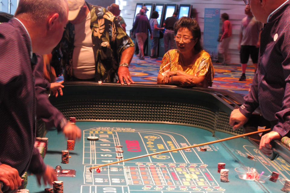 Gamblers play a game of craps at the Ocean Casino Resort in Atlantic City N.J., on June 18, 2019. In a lawsuit filed Thursday, Aug. 27, 2020, Atlantic City's top casino, the Borgata, accuses Ocean Casino Resort of poaching its top marketing executives, including one with a cell phone containing priceless information on the Borgata's top customers, who spend $1.5 million to $4 million per visit. (AP Photo/Wayne Parry)