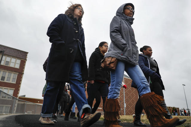 <p>Students gather on their soccer field during a 17-minute walkout protest at the Stivers School for the Arts, Wednesday, March 14, 2018, in Dayton, Ohio. Students across the country planned to participate in walkouts Wednesday to protest gun violence, one month after the deadly shooting inside a high school in Parkland, Fla. (Photo: John Minchillo/AP) </p>