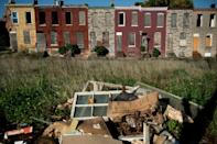 Boarded up rowhouses and piles of trash are common sights in east the poor neighborhoods of east Baltimore