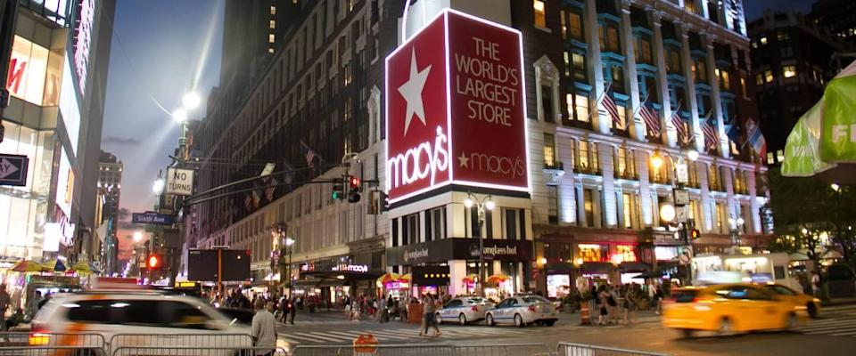 Macy's store exterior at night.