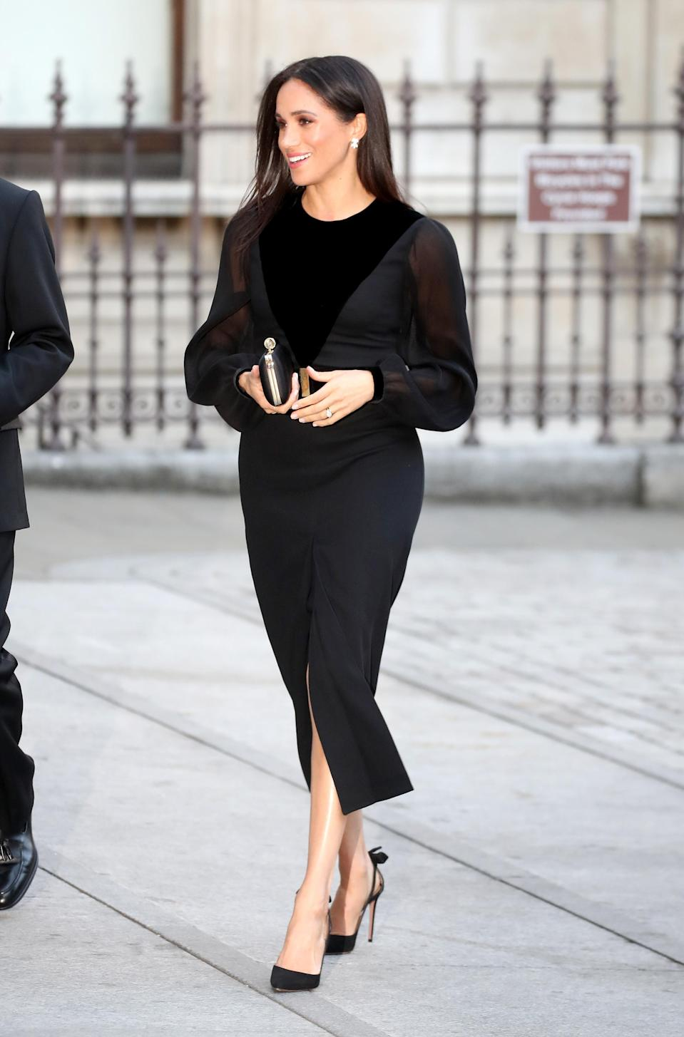 <p>Meghan Markle opened 'Oceania' at Royal Academy of Arts on September 25, marking her first solo outing since becoming a royal. For the occassion, the Duchess wore a two-tone, sheer black Givenchy dress with billowing sleeves and her favourite Aquazzura heels. <em>[Photo: Getty]</em> </p>
