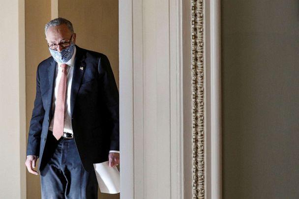 PHOTO: Senate Majority Leader Chuck Schumer, D-N.Y., exits his office on his way to a photo op with freshman senators at the U.S. Capitol in Washington, Jan. 21, 2021. (Tom Brenner/Reuters)