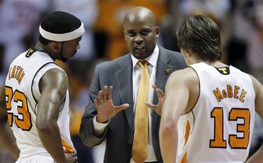Tennessee head coach Cuonzo Martin, center, talks with Cameron Tatum (23) and Skylar McBee (13) in the first half of an NCAA college basketball game against Kentucky on Saturday, Jan. 14, 2012, in Knoxville, Tenn. Kentucky won 65-62. (AP Photo/Wade Payne)