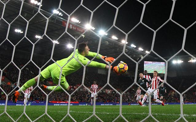 "Soccer Football - Premier League - Stoke City vs Manchester City - bet365 Stadium, Stoke-on-Trent, Britain - March 12, 2018 Manchester City's David Silva scores their first goal REUTERS/Hannah McKay EDITORIAL USE ONLY. No use with unauthorized audio, video, data, fixture lists, club/league logos or ""live"" services. Online in-match use limited to 75 images, no video emulation. No use in betting, games or single club/league/player publications. Please contact your account representative for further details. TPX IMAGES OF THE DAY"