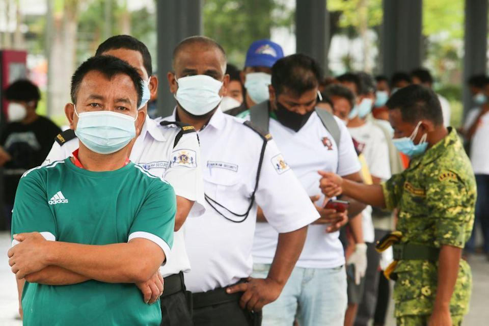 Hundreds of migrant workers in Penang had gone to the walk-in vaccination centres for locals last Thursday, when the government started the programme. ― Picture by Choo Choy May