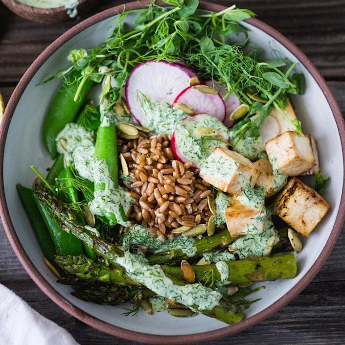 <p>This healthy grain bowl packs in the greens with peas, asparagus and a creamy yogurt dressing. Tofu adds protein while keeping it vegetarian, but you could also swap in cooked shrimp or chicken for a satisfying dinner or packable lunch ready in just 15 minutes.</p>