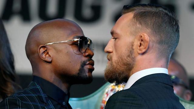 Floyd Mayweather (L) and Conor McGregor will meet in the ring on Saturday. (Getty)
