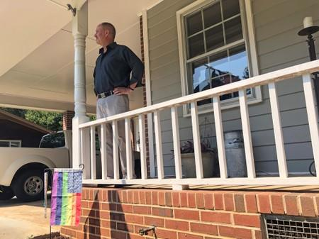 Gerald Bostock, who says he lost his job because he is gay, stands outside his home in Atlanta