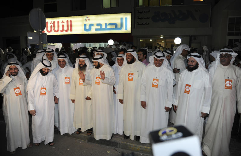 Men gather for a demonstration in Press Street, Shuwaikh, Kuwait, Wednesday, Oct. 31, 2012. Witnesses say riot police have used tear gas and stun grenades to drive back more than 2,000 protesters demanding the release of a jailed opposition leader. (AP Photo/Gustavo Ferrari)