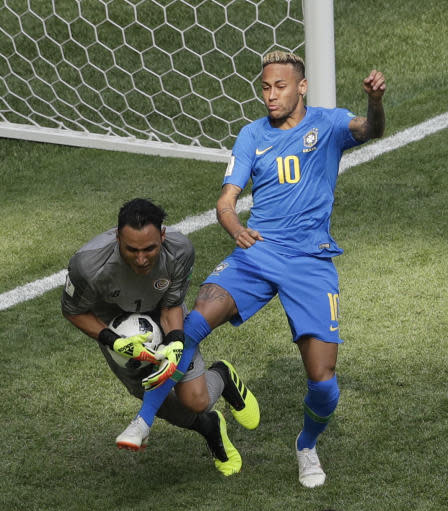 Costa Rica goalkeeper Keylor Navas, left, challenges for the ball with Brazil's Neymar during the group E match between Brazil and Costa Rica at the 2018 soccer World Cup in the St. Petersburg Stadium in St. Petersburg, Russia, Friday, June 22, 2018. (AP Photo/Michael Sohn)