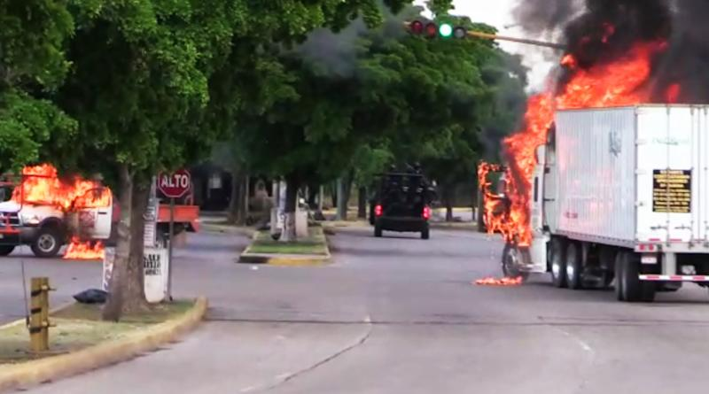 """In this AFPTV screen trucks burn in a street of Culiacan, capital of jailed kingpin Joaquin """"El Chapo"""" Guzman's home state of Sinaloa, on October 17, 2019. - Heavily armed gunmen in four-by-four trucks fought an intense battle against Mexican security forces Thursday in the city of Culiacan, capital of jailed kingpin Joaquin """"El Chapo"""" Guzman's home state of Sinaloa. (Photo by STR / AFP) (Photo by STR/AFP via Getty Images)"""