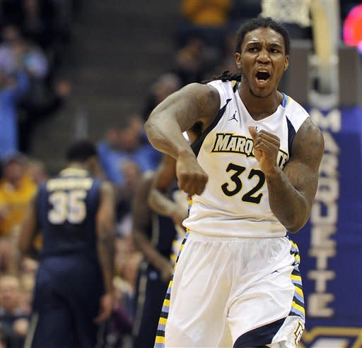 Marquette's Jae Crowder (32) celebrates a basket late in the game against Pittsburgh during the second half of an NCAA college basketball game Saturday, Jan. 14, 2012, in Milwaukee. Marquette defeated Pittsburgh 62-57. (AP Photo/Jim Prisching)
