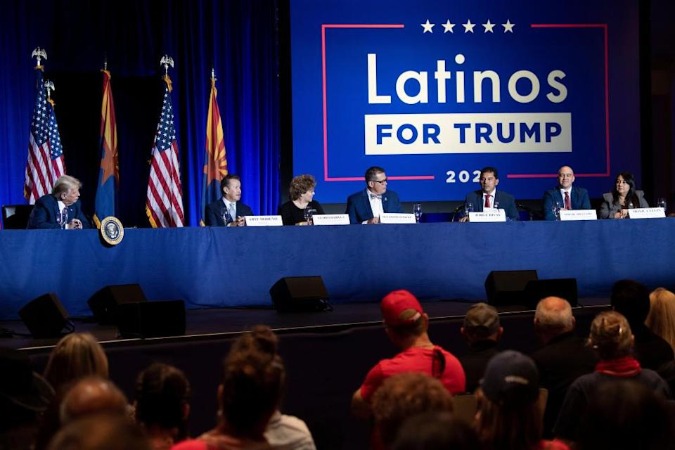 US President Donald Trump (L) and others participate in a roundtable rally with Latino supporters at the Arizona Grand Resort and Spa in Phoenix, Arizona on September 14, 2020.