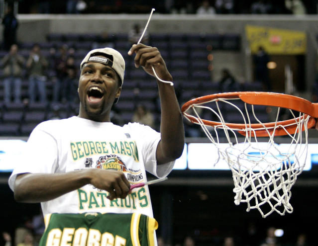 FILE - In this March 26, 2006, file photo, George Mason's Folarin Campbell cuts the net after beating Connecticut 86-84 in overtime during the fourth round of the NCAA college basketball tournament in Washington. (AP Photo/Haraz N. Ghanbari, File)