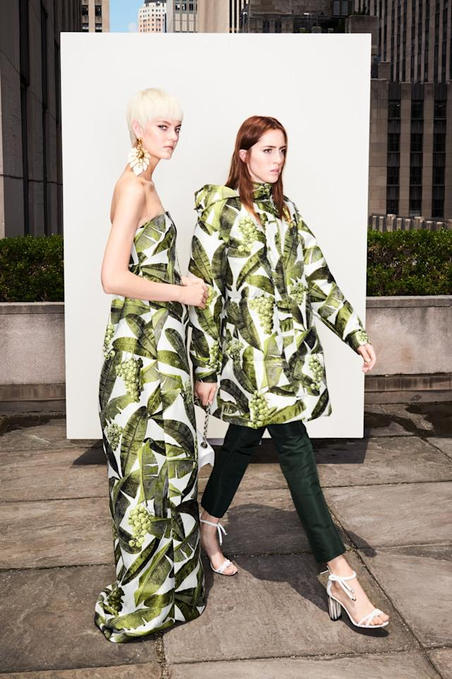 <p>Models showcasing de la Renta's white and green banana leaf print — one in a jacquard strapless empire waist gown and the other in a quilted coat with dark pants. (Photo: Courtesy of Oscar de la Renta) </p>