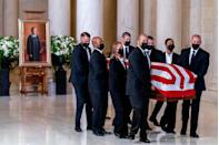<p>The flag-draped casket of Associate Justice Ruth Bader Ginsburg, carried by Supreme Court police officers, arrives in the Great Hall at the U.S. Supreme Court, on September 23, 2020 in Washington, DC.</p>