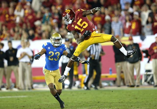 LOS ANGELES, CA - NOVEMBER 30: Wide receiver Nelson Agholor #15 of the USC Trojans comes down with a reception in front of safety Anthony Jefferson #23 of the UCLA Bruins at Los Angeles Coliseum on November 30, 2013 in Los Angeles, California. (Photo by Stephen Dunn/Getty Images)