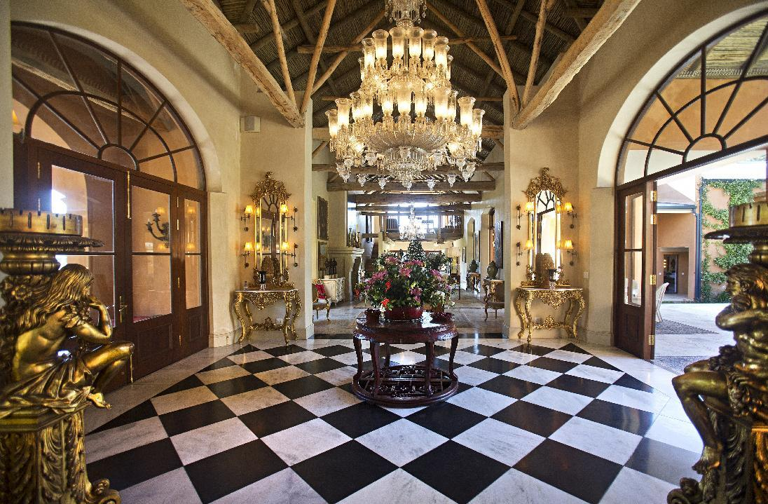 Opulence comes in the form of marble tiles and Indian chandliers hanging from vaulted ceiings.