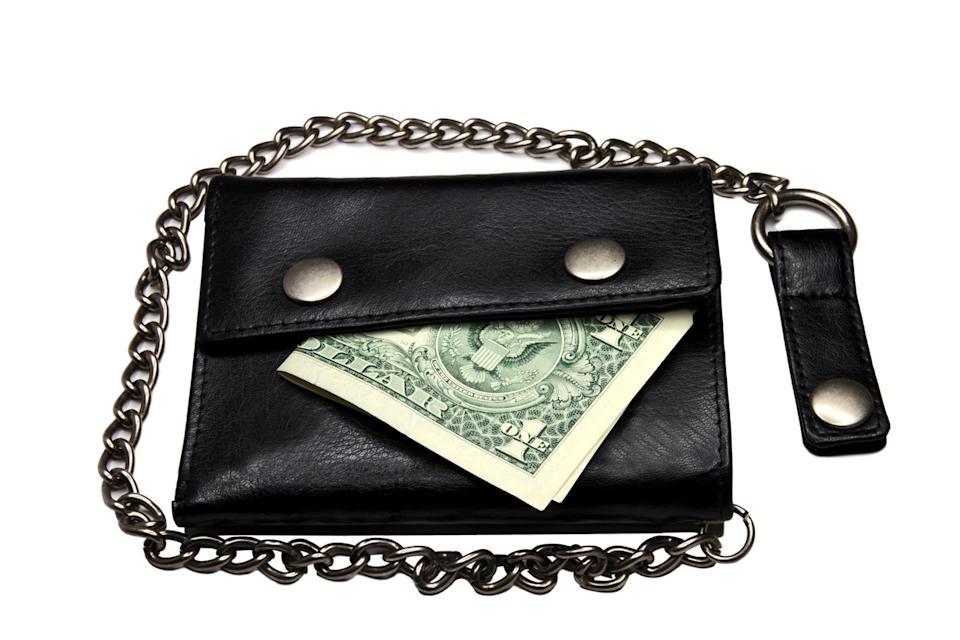 black wallet with chain and one dollar inside, a 90s fashion trend