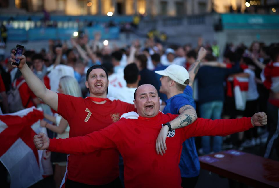England fans react in Trafalgar Square during the match (REUTERS)
