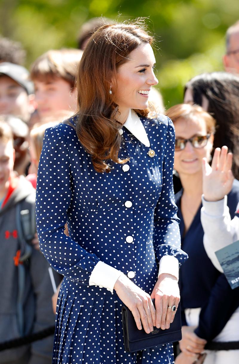 In May, Kate Middleton wore a stylish blue-and-white polka dot dress to Bletchley Park in England. (Photo: Getty Images)