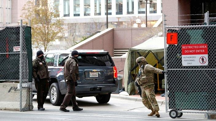 """Hennepin County Sheriff Deputies and the US Army National Guard help secure the Hennepin County Government Center during closing arguments for former Minneapolis Police officer Derek Chauvin""""s murder trial at the Hennepin County Government Center, in Minneapolis, US, on 19 April 2021"""