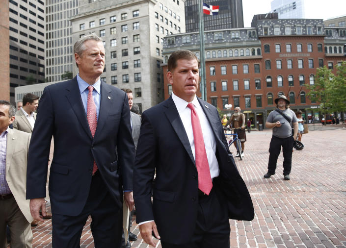 Mayor Marty Walsh, right, and Massachusetts Gov. Charlie Baker arrive to speak at a press conference to discuss a controversial rally planned for Saturday on Boston Common. (Photo: Jessica Rinaldi/Boston Globe via Getty Images)