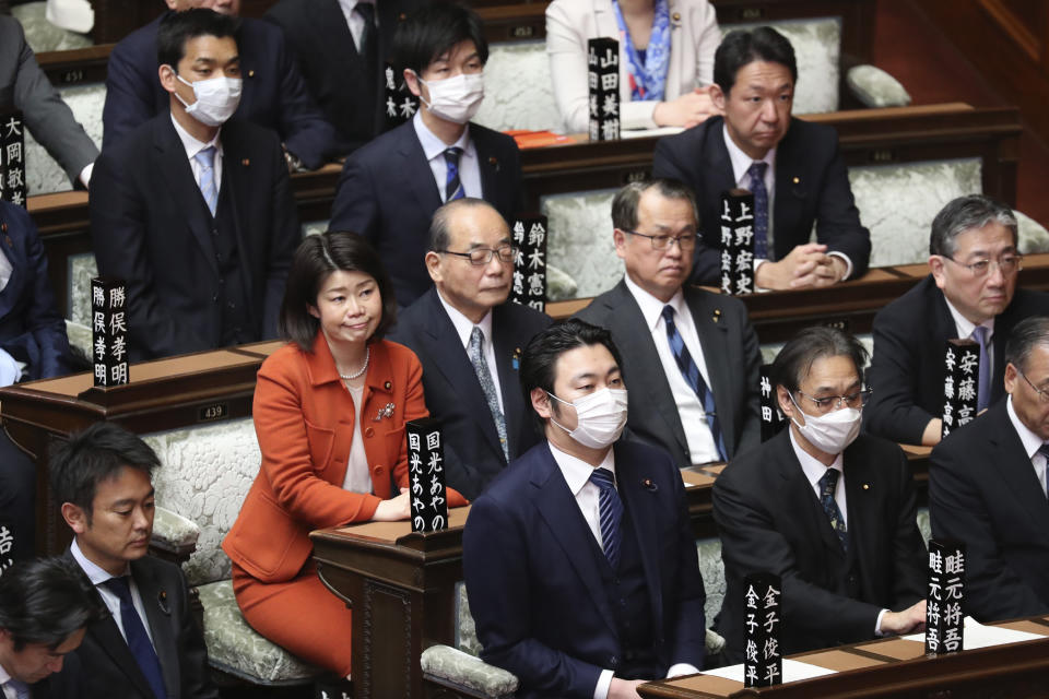 FILE - In this March 12, 2020, file photo, lawmakers attend a plenary session at the Lower House in Tokyo. The inclusion of two women among the four candidates vying to become the next prime minister seems like a big step forward for Japan's notoriously sexist politics. But their fate is in the hands of a conservative, mostly male governing party - and the leading female candidate has been criticized by observers for her right-wing gender policies. (AP Photo/Koji Sasahara, File)