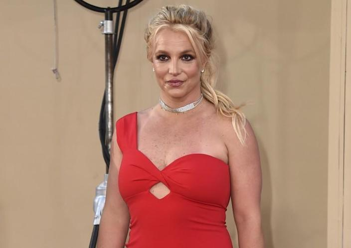A woman in a red off-the-shoulder dress