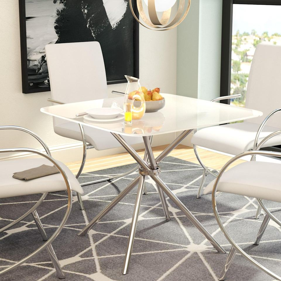 <p>The frosted glass, geometric pedestal base and rounded edges give this <span>Orren Ellis Mahaney Dining Table Set</span> ($225, originally $240) a unique silhouette. It will not only be at the center of your dinner parties, but it will also elevate your space with a contemporary chrome touch.</p>