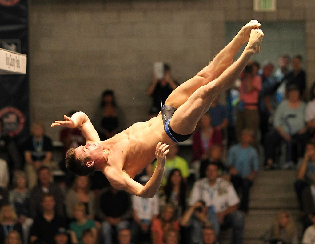"He may be upside down, but we can spot a six-pack from any angle! David Boudia has known since he was 7 that he wanted to be an Olympian -- he just didn't know for which sport. After trying gymnastics and soccer, diving eventually stuck. And it's a rush that never gets old for him. The 33-foot drop ""is like you're flying out of a plane,"" describes 23-year-old Boudia, who competed in Beijing. ""It's a huge adrenaline rush and  after you go out of the water onto the pool deck, you're shaking so much  just because your body is in so much shock and your adrenaline is just  pumped."""
