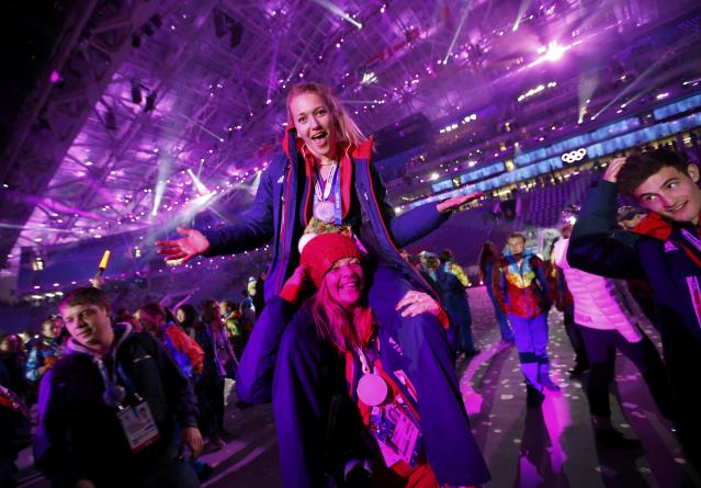 Athletes party on stage after the closing ceremony for the Sochi 2014 Winter Olympic Games February 23, 2014. REUTERS/Marko Djurica (RUSSIA - Tags: OLYMPICS SPORT)