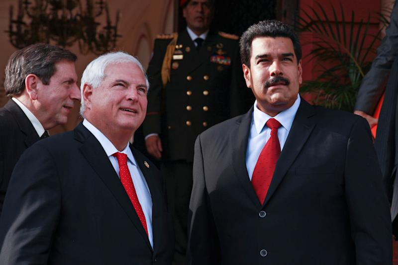 In this photo released by Miraflores Press Office, Venezuela's Nicolas Maduro, right, stands with Panama's President Ricardo Martinelli at Miraflores presidential palace in Caracas, Venezuela, Monday, July 8, 2013. (AP Photo/Miraflores Press Office)
