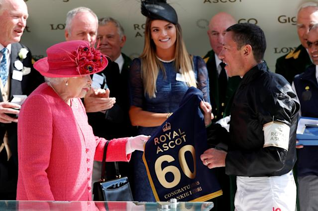 REFILE - CORRECTING TYPO Horse Racing - Royal Ascot - Ascot Racecourse, Ascot, Britain - June 21, 2018 Britain's Queen Elizabeth presents Frankie Dettori with a banner commemorating his 60th Royal Ascot win Action Images via Reuters/Paul Childs