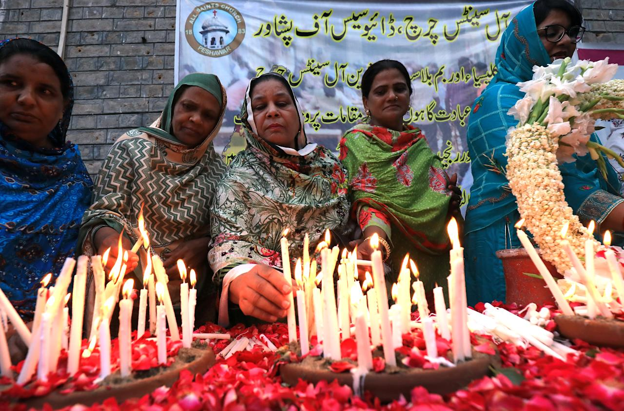 People light candles for the victims of Sri Lanka's serial bomb blasts, at the All Saints Church in Peshawar, Pakistan April 24, 2019. REUTERS/Fayaz Aziz