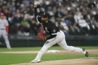 Chicago White Sox starter Reynaldo Lopez delivers a pitch during the first inning of a baseball game against the Cincinnati Reds Tuesday, Sept. 28, 2021, in Chicago. (AP Photo/Paul Beaty)