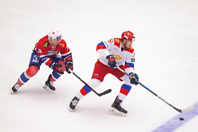 Ice Hockey - International Friendly - Norway v Russia B - Gjoevik, Norway - April 14, 2018 - Norway's Tobias Lindstroem and Russia's Alexei Bereglazov in action. NTB Scanpix/Fredrik Hagen via REUTERS ATTENTION EDITORS - THIS IMAGE WAS PROVIDED BY A THIRD PARTY. NORWAY OUT. NO COMMERCIAL OR EDITORIAL SALES IN NORWAY.