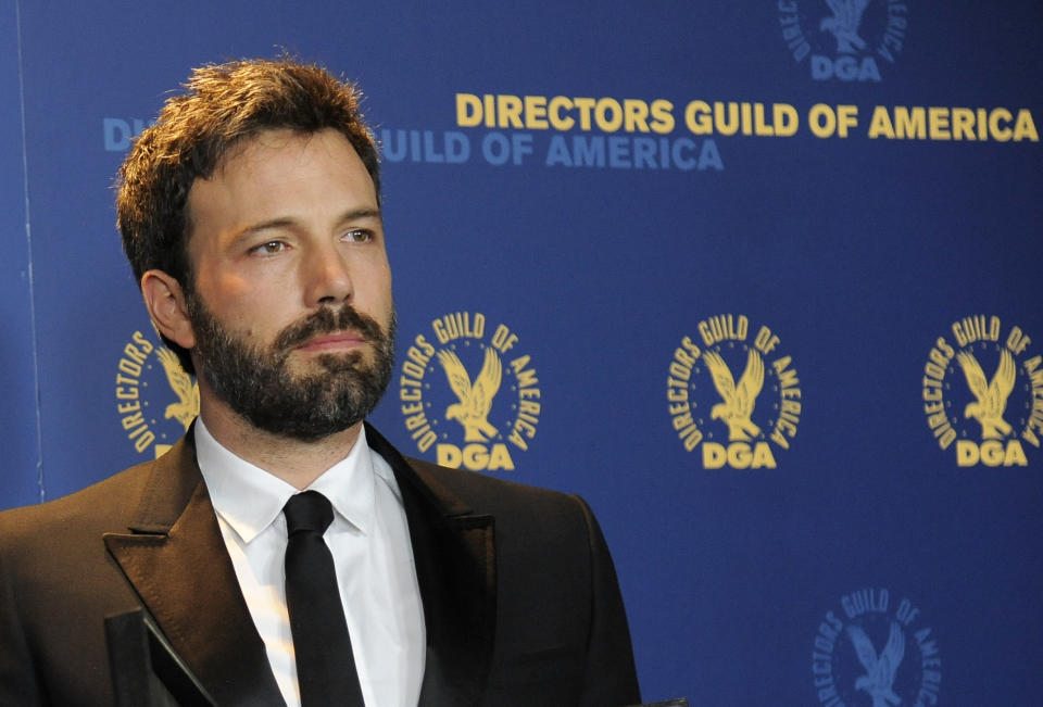 Ben Affleck poses backstage with his award for outstanding directorial achievement in feature film for