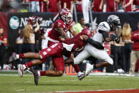 Memphis running back Kylan Watkins (17) runs the ball on his way to a touchdown as Temple linebacker Chapelle Russell (3) and cornerback Christian Braswell (14) try to stop him during the second half of an NCAA college football, Saturday, Oct. 12, 2019, in Philadelphia. Temple won 30-28. (AP Photo/Chris Szagola)