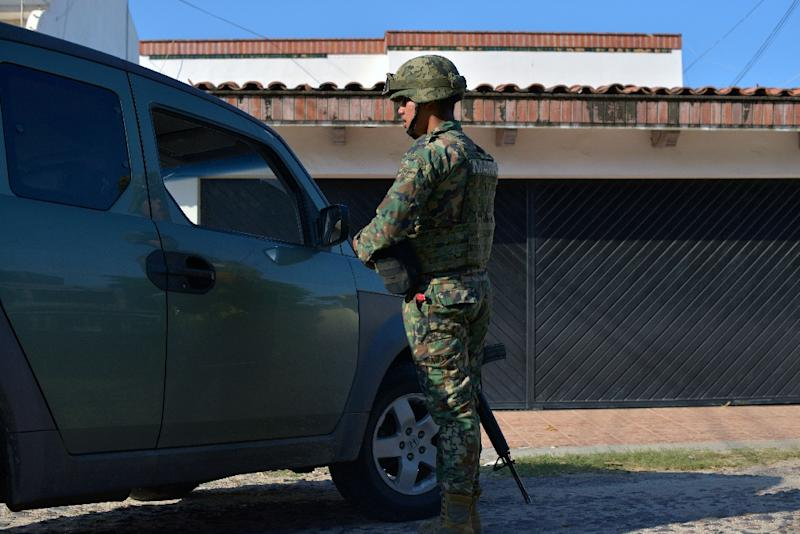 A member of the Mexican Navy stands guard in a street of Culiacan, Sinaloa state, Mexico during a security operation on October 20, 2015