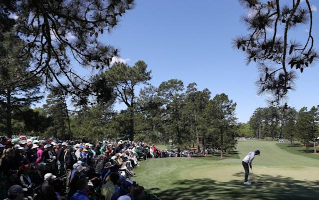 <span>Rory McIlroy putting on the seventh hole</span> <span>Credit: EPA </span>