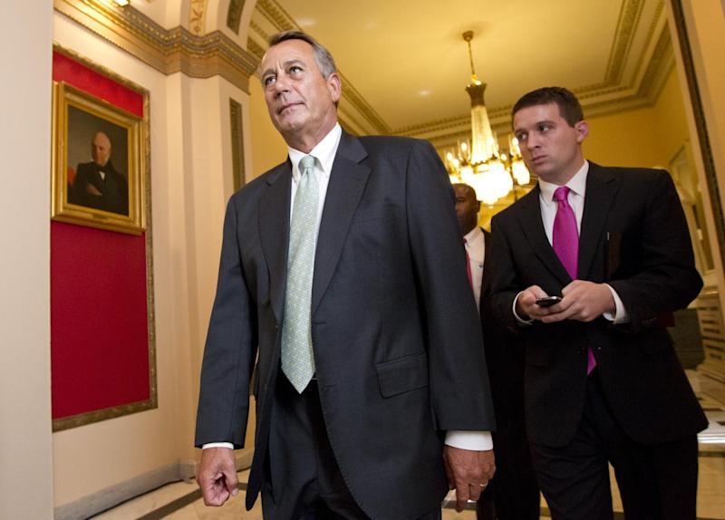 House Speaker John Boehner of Ohio, left, leaves the House chamber on Capitol Hill in Washington, Wednesday, July 11, 2012, after the Republican-controlled House voted 244-185 to repeal President Barack Obama's health care law. (AP Photo/J. Scott Applewhite)