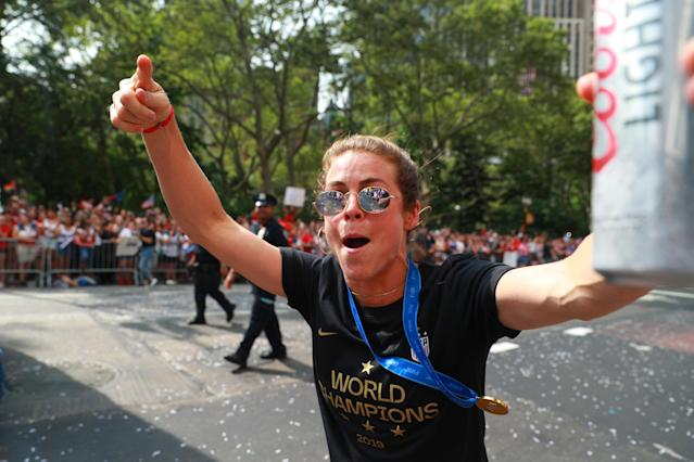 Kelley O'Hara of the U.S. women's soccer team celebrates with fans during a parade along the Canyon of Heroes, July 10, 2019, in New York. (Photo: Gordon Donovan/Yahoo News)