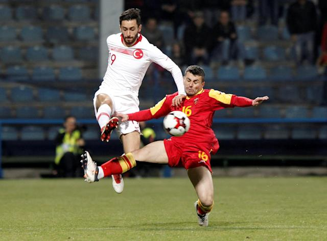 Soccer Football - International Friendly - Montenegro vs Turkey - Podgorica City Stadium, Podgorica, Montenegro - March 27, 2018 Turkey's Yunus Malli in action with Montenegro's Vladmir Jovovic REUTERS/Stevo Vasiljevic TPX IMAGES OF THE DAY