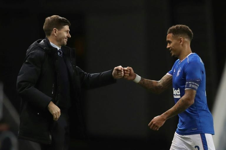 Rampant: James Tavernier (right)scored his 13th goal of the season as Rangers moved 11 points clear at the top of the Scottish Premiership